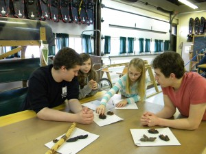 Students identifying tracks and scat with the help of two Wetheads.